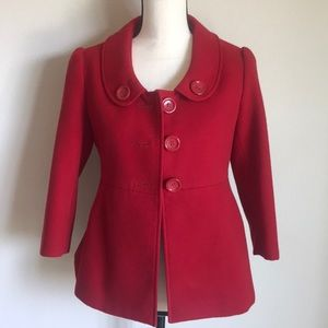 Red jacket, lined with bottoms and 3/4 sleeves.